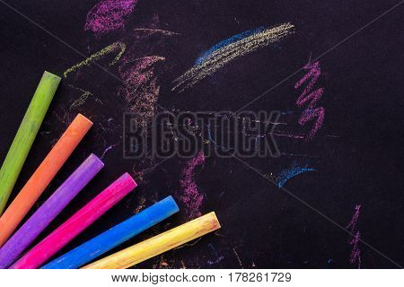 Blank school board with color chalk, business concept