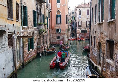 Venice Channel Infrastructure. People In Boats And Gondolas