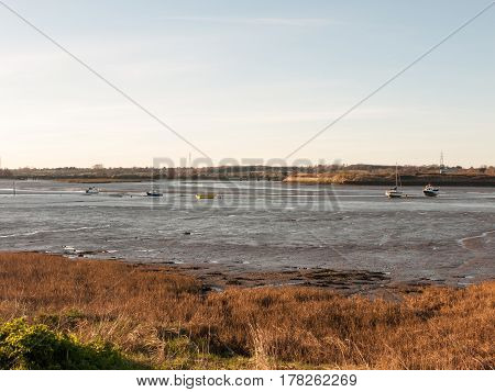 A wonderful shot of the river and its bank with the tide out on a clear day