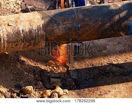 Worker Staff Cut Big Metal Tube With Grinder. Burning Red Parks