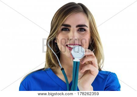 Smiling nurse auscultating on white background