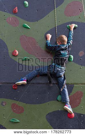 LEEUWARDEN NETHERLANDS - JUNE 6 2016: Unknown boy on a military climbing wall