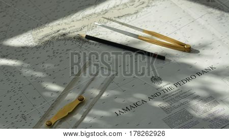 Navigation tools (parallel rule, pen, divider) on chart