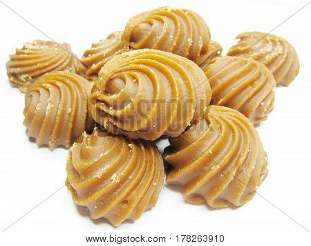 dairy brown sweetmeats in heap isolated sweet dessert
