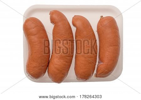 isolated plastic package with sausages on the white background