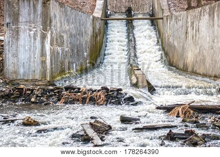 Concrete chute water. Spring creek under the bridge