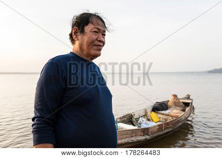 Asian fisherman in nature river at the early morning before sunrise