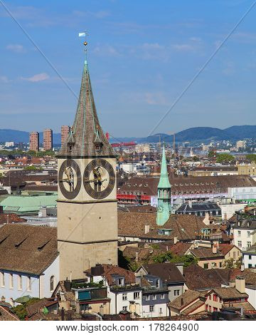 Zurich, Switzerland - 31 August, 2015: view of the city from the tower of the Grossmunster Cathedral, clock tower of the St. Peter Church in the foreground. Zurich is the largest city in Switzerland and the capital of the Swiss canton of Zurich.
