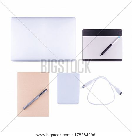 Top View Of Laptop And External Hard Disk Isolated On White Background.