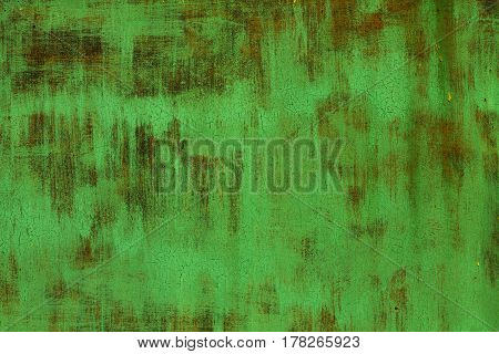 Old shabby dyed green rusty textured steel sheet metal