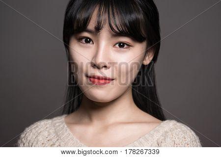 Studio portrait of a happy twenties Asian woman