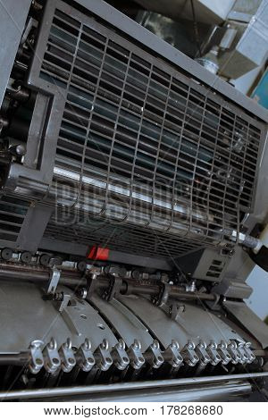Offset printing machine in details. Macro photo
