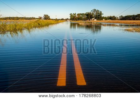 A road under water by a hurricane