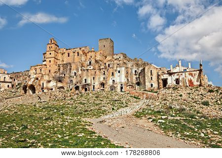 Craco, Matera, Basilicata, Italy: view of the ghost town that was abandoned  due to natural disasters and now is a tourist attraction and a filming location