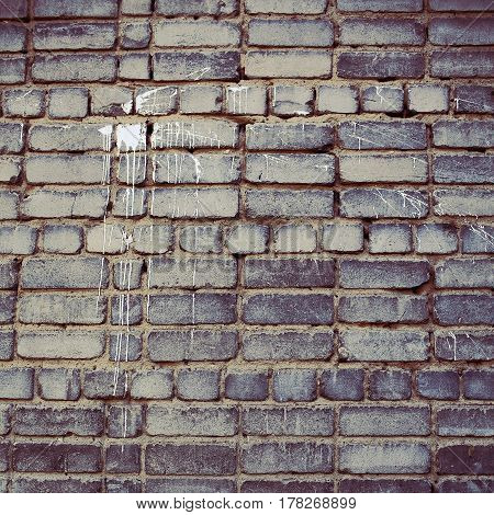 Dirty stained grey brick wall. Wall background with space for text