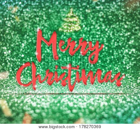 Merry Christmas Word At Sparkling Green Glitter Background With Confetti ,holiday Greeting Card