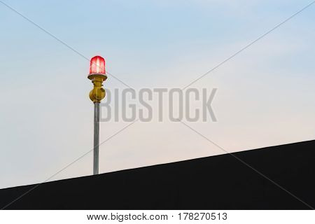 Aircraft warning lights at roof of high rise building at evening time