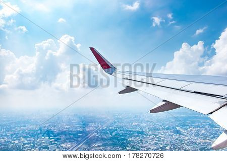 Aerial view from airplane see landscape view of Bangkok and blue skyTravelling concept.
