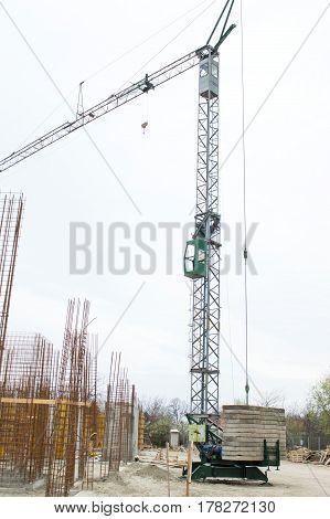 Construction Site Crane at a Construction Site Against Blue Sky concrete blocks armature
