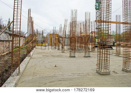 Construction site. Concrete blocks. Armature. Machine. Reconstruction area.