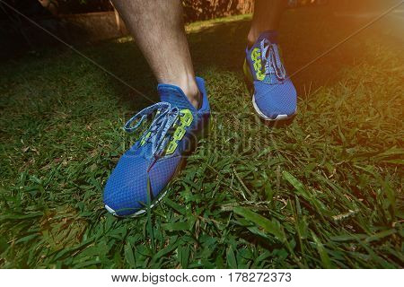 Man Waring Modern Running Shoes