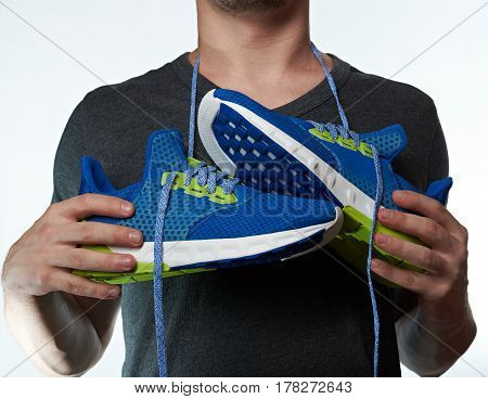 Sport Shoes Hang On Man Neck