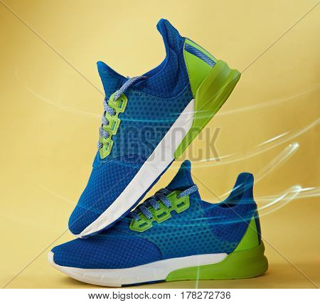 Pair Of Blue Colorful Running Shoes