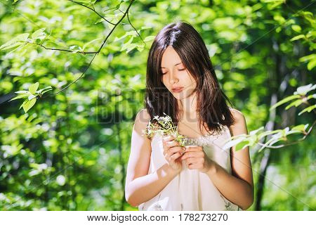 Portrait Of Young Woman On Natural Green Background.
