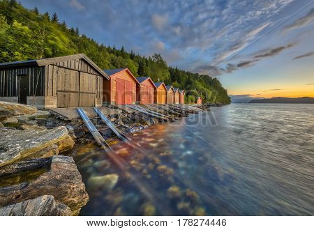 Colorful Boathouse In Norwegian Fjord