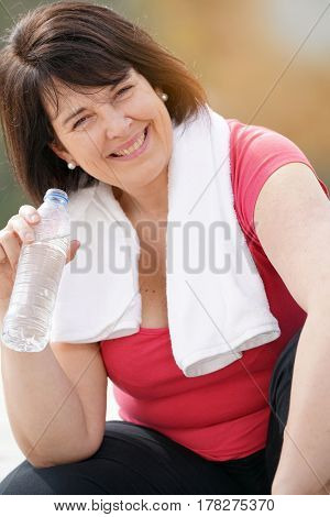 Portrait of overweight woman in fitness outfit