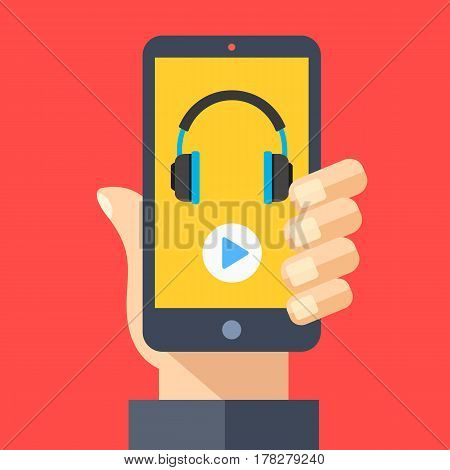 Headphones and play button on smartphone screen. Hand holding smartphone. Streaming service, music app, listening to music on mobile device. Modern flat design graphic elements. Vector illustration