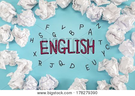 English text with crumpled paper balls on a blue background