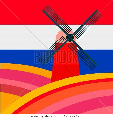 Mill with tulipan fields against the background of the Dutch flag