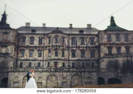 Stunning Married Couple Kisses In The Front Of An Old Castle