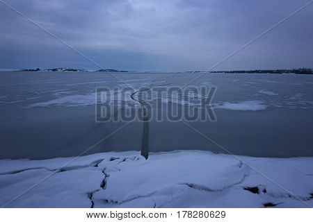 Frozen Lake. Beautiful stratus clouds over the ice surface on a frosty day. Natural background