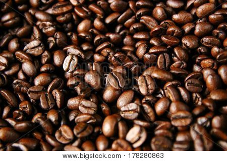 Closeup of roasted coffee beans after roasting in a drum type coffee roaster