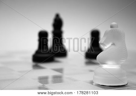 Glass chess figures, black and white, pawn, knight