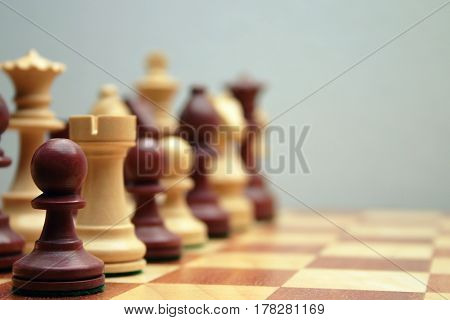 Wodden chess figures, brown, pawn, queen, castle