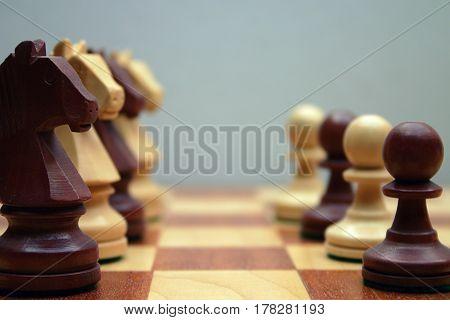 Wodden chess figures, pawn, knight, brown, chessman