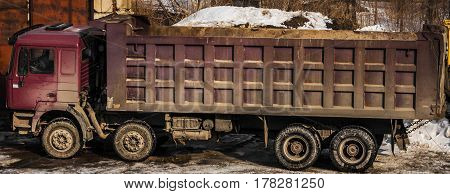 Lorry, truck, tip truck, tip lorry, dump truck, trucking industry, large truck view from above, dumper