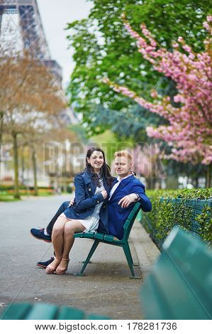 Romantic Couple In Paris Near The Eiffel Tower