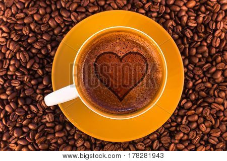 heart on fresh espresso with a beautiful crema and strewn mediumly roasted coffee beans