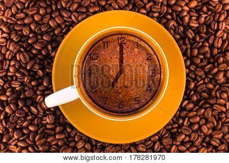 seven o'clock on fresh espresso with a beautiful crema and strewn mediumly roasted coffee beans