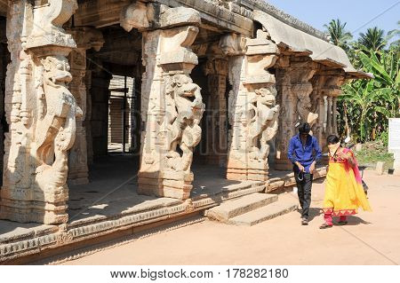 People Walking In Front Of The Royal Centre On Hampi