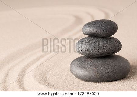 spa wellness hot stone therapy or zen meditation stones and sand for relaxation and concentration.