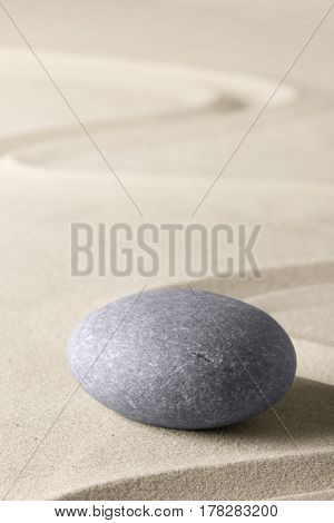 Spa wellness relaxation background with sand and stones like for zen meditation.