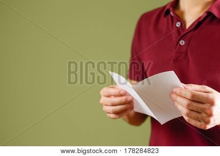 Man Reading Blank White Flyer Brochure. Read Detailed Booklet. Leaflet Presentation. Pamphlet Hold H