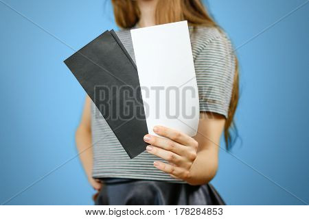 Woman Showing Two Blank White And Black Flyer Paper. Leaflet Presentation. Pamphlet Hold Hands. Girl