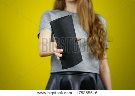 Woman Showing Blank Black Flyer Paper. Leaflet Presentation. Pamphlet Hold Hands. Girl Show Clear Of