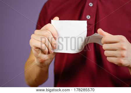 Man Tearing A Piece Of Paper In Half Blank White Flyer Brochure Booklet. Leaflet Presentation. Pamph